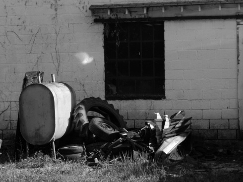 black and white photograph of a junk pile