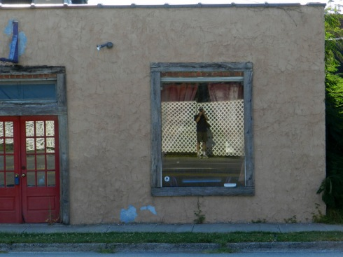 self portrait of Doug Couvillion reflected in a window