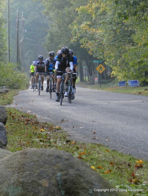 photograph of cyclist riding in a pace line