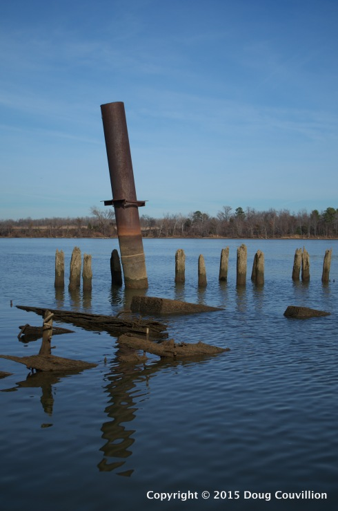 photograph of a rusted piling in the James River near Richmond, VA