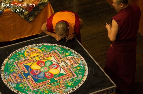 photograph of Tibetan monks working on a mandala