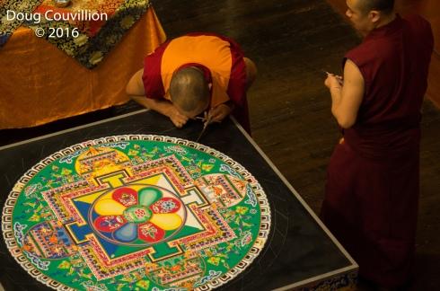 photograph of Tibetan monks working on a mandala